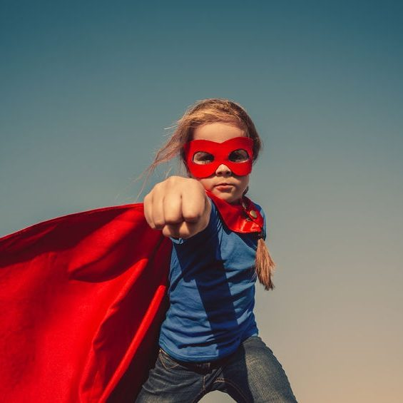 39419817 - funny little power super hero child (girl) in a red raincoat. superhero concept. instagram colors toning